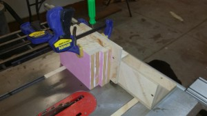 The workpieces are clamped to the slider, which travels along the jig.